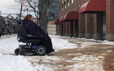 Wheelchair and snow in Portland. Accessibility on the sidewalks is difficult in the winter season.